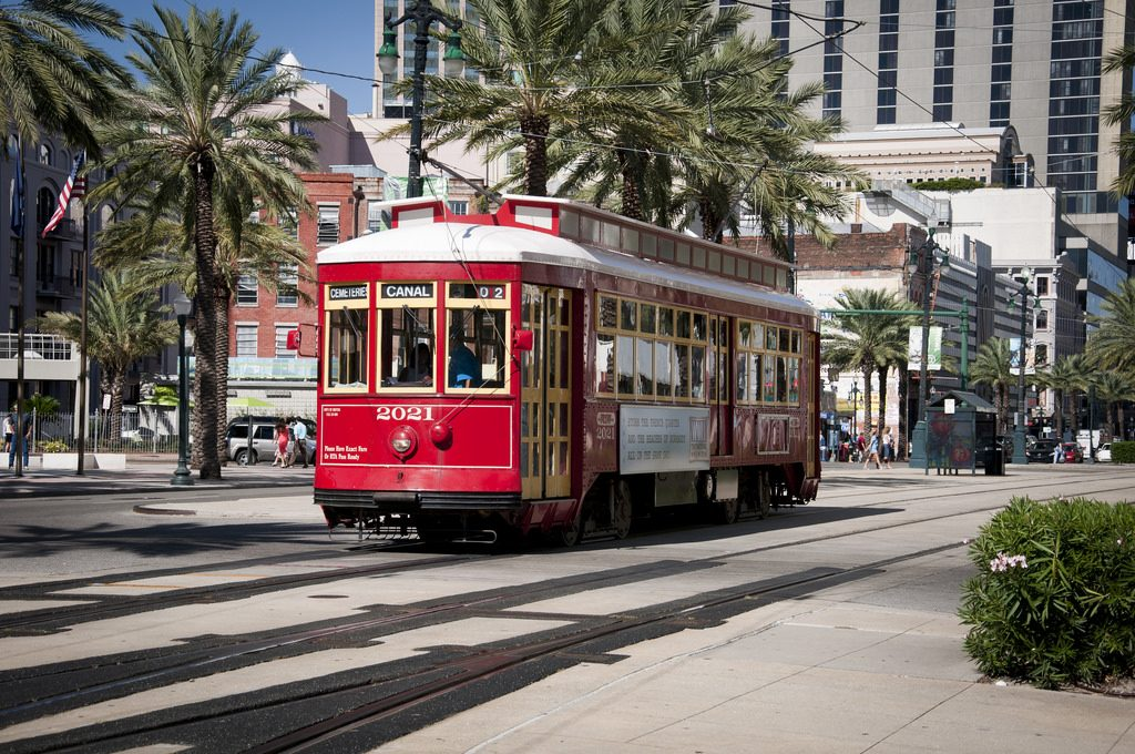 Candy-Apple red New Orleans streetcar repaired by Brookville Equipment and TMV Control Systems