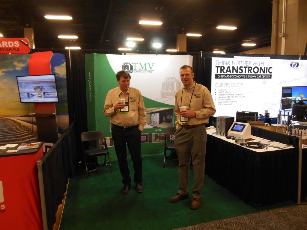 Derick Vander Klippe and Jay Rafferty at TMV Control Systems booth at Trade Show