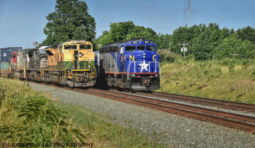 #1871 F59PH NCDOT train passing an older looking engine
