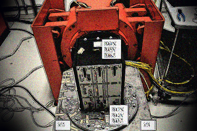 TECU attached to a big red vibration machine to test the strength of the electronic connections under shock and vibration