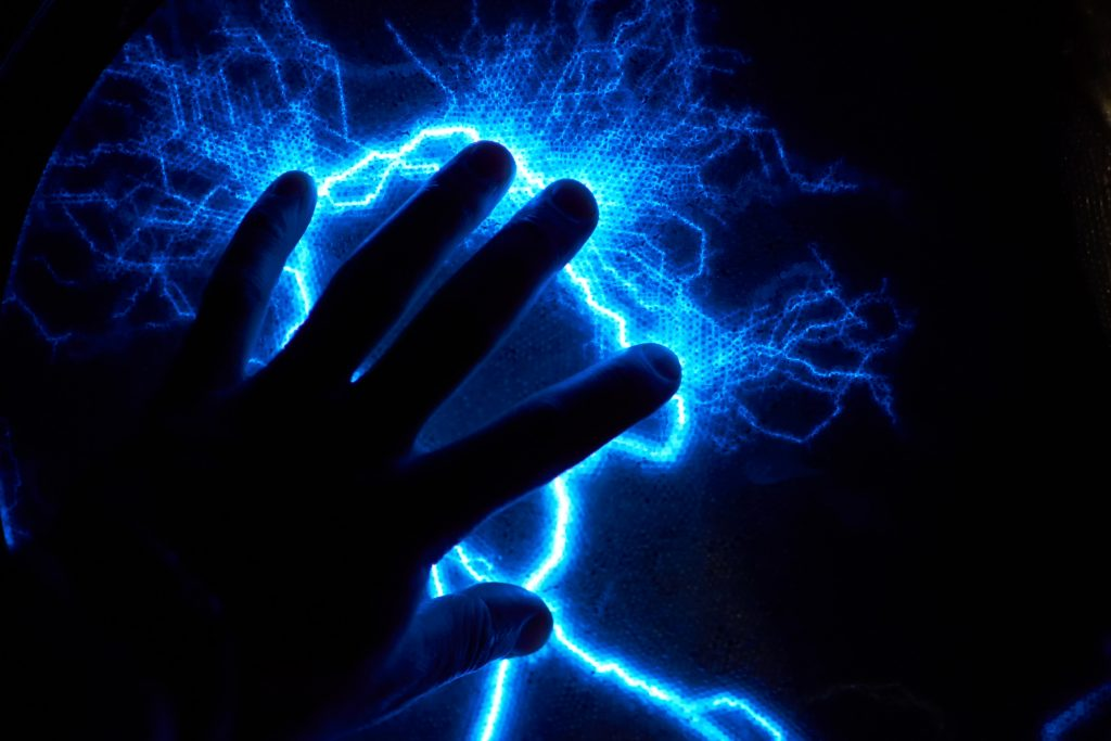 human hand static electricity also known as electrostatic discharge blue and black looks like lightning
