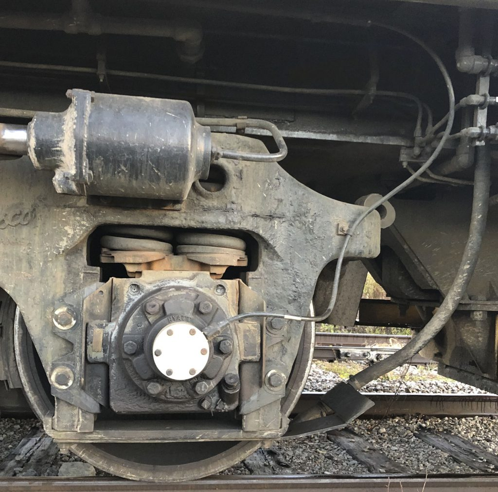 Installed TMV axle generator in the axle of a large locomotive, with cable routed to main electrical cabinet inside the locomotive for accurate speed sensing